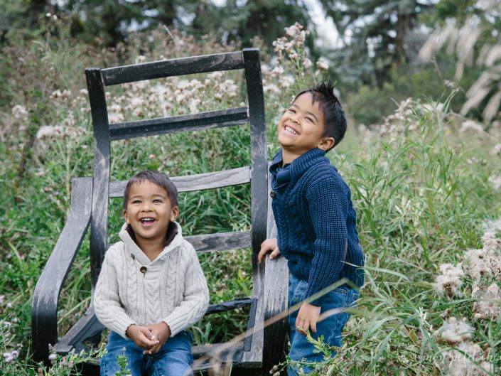 Two brothers laughing at a family photo shoot