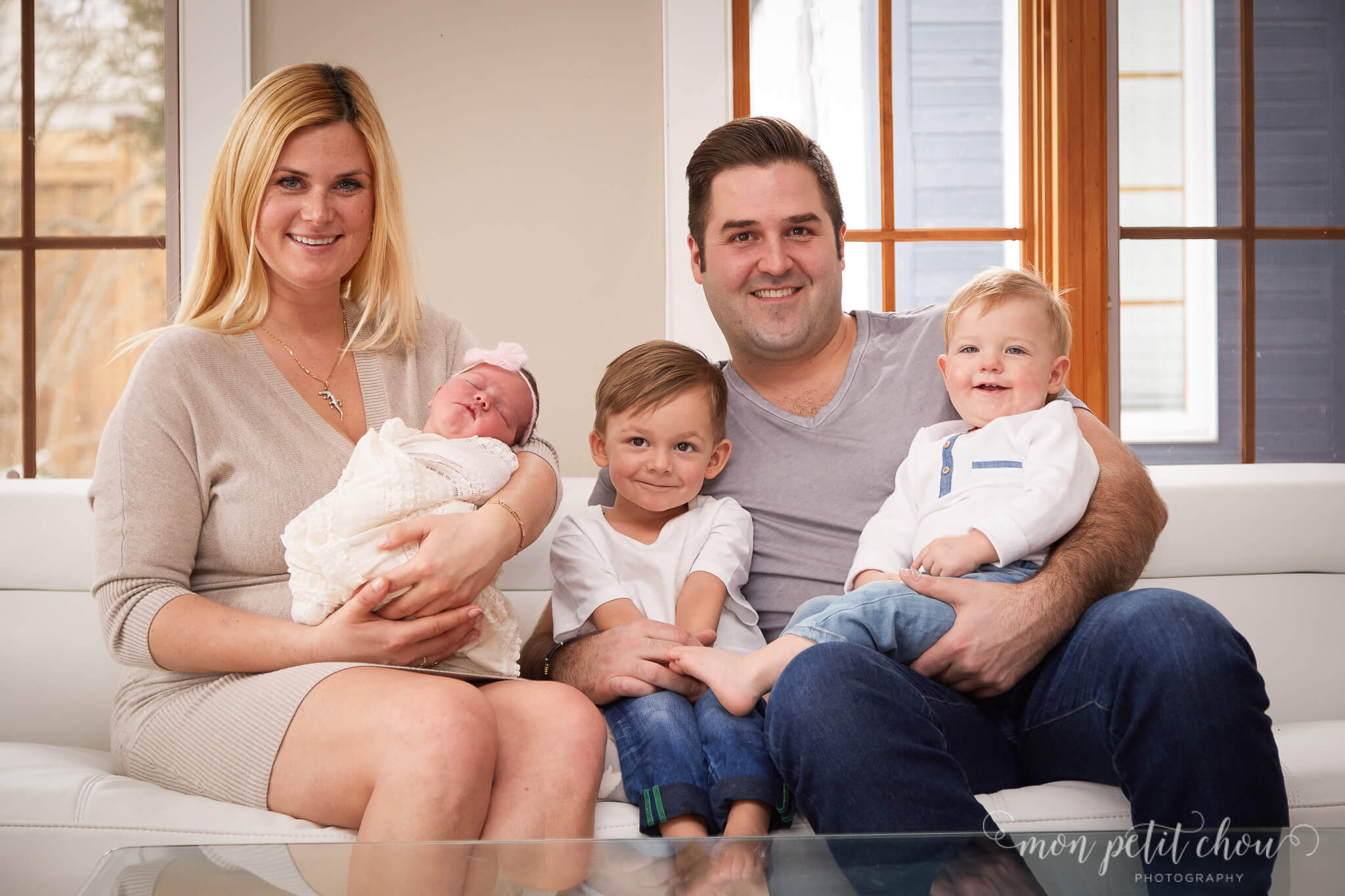 Photos of family with mom, dad, two toddlers and newborn, taken in Port Credit Toronto