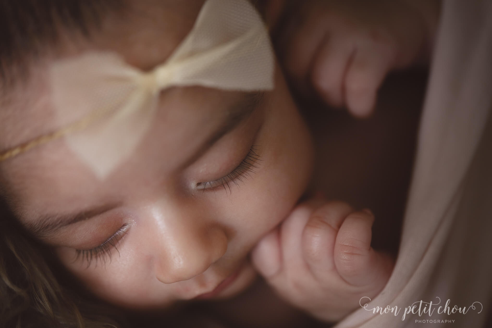 Macro photo of a newborn with gorgeous lashes in focus.