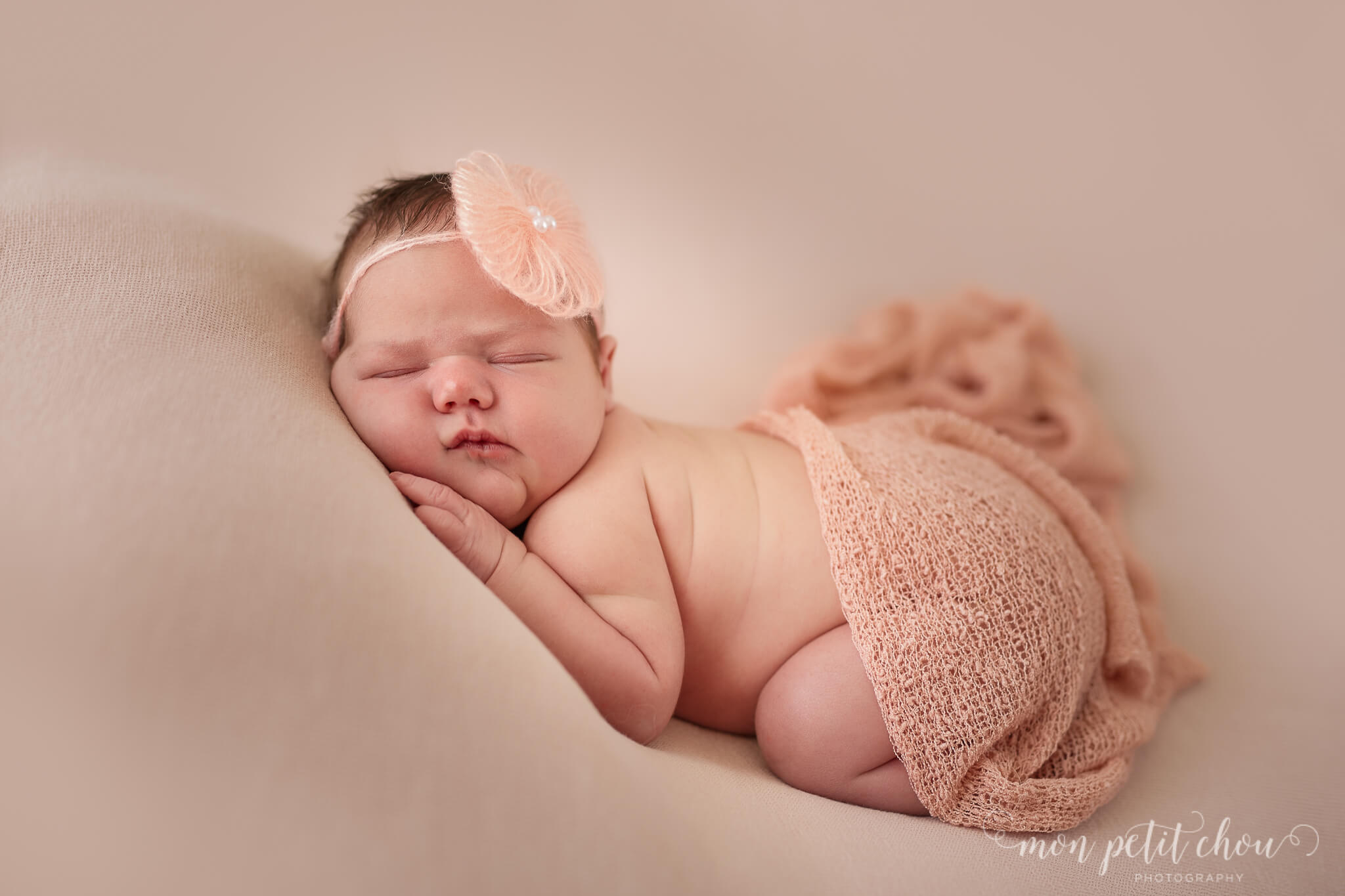 Cute baby girl covered in wool blanket sleeping