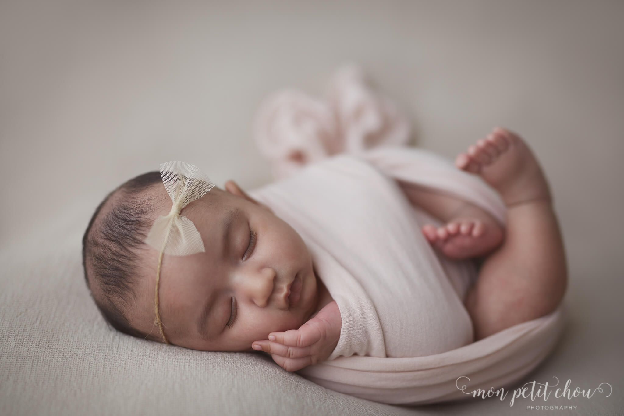 Wrapped baby girl sleeping during a newborn shoot in Markham.