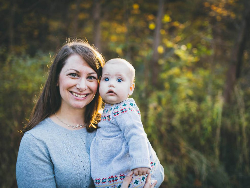 Mom holding baby during a family photo shoot in Oakville
