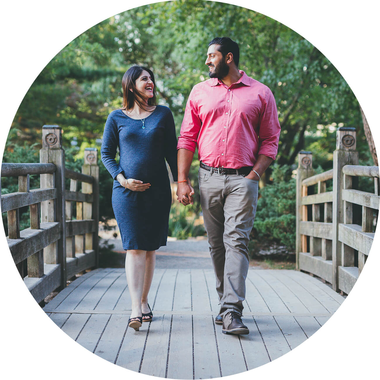 Pregnant mom holding hands with father during a maternity photo shoot