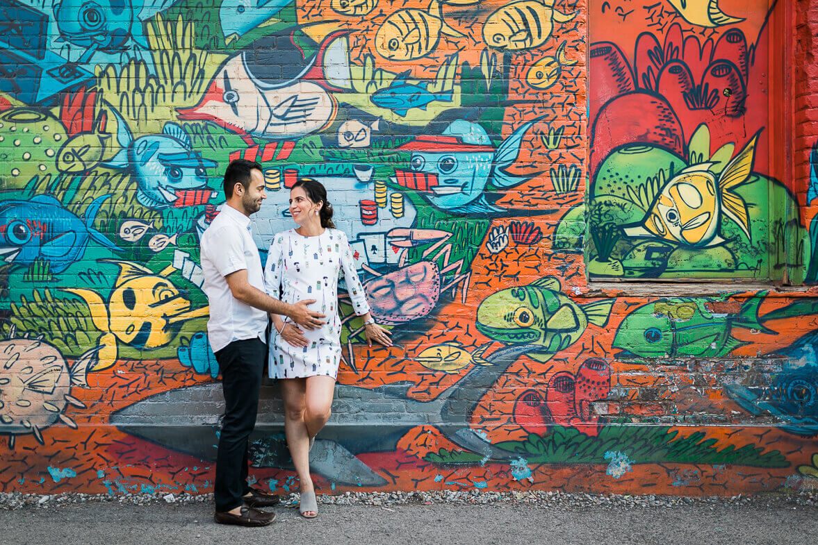 Pregnant mom leaning against wall in Graffiti Alley in Toronto downtown
