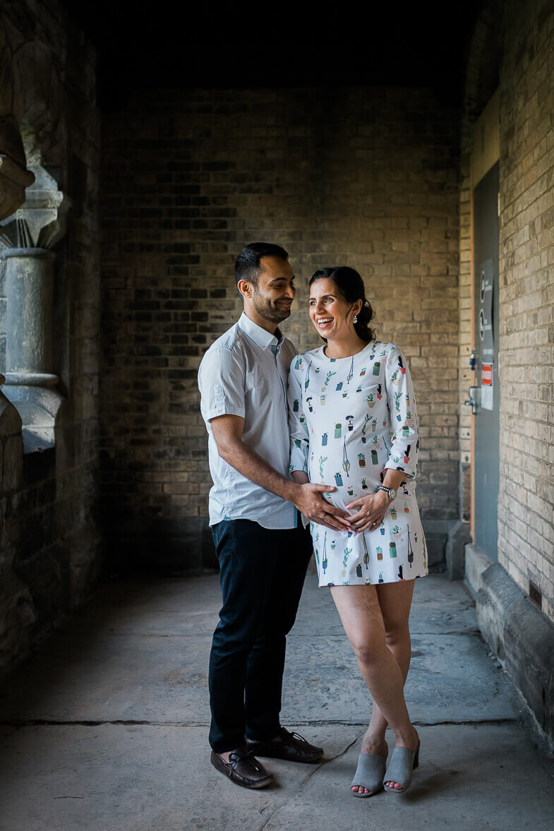 Man and pregnant wife at University of Toronto Hart House