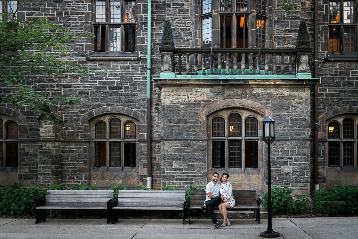 Man and woman sitting at University of Toronto courtyard