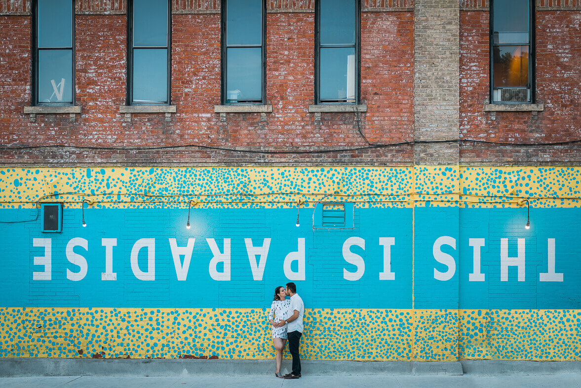 This is paradise wall in Toronto with man and woman kissing